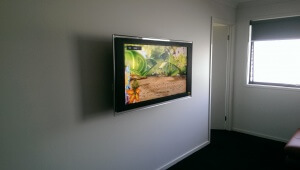 TV Mounted on the wall with speakers